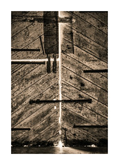 CRACKS OF LIGHT (Barry Haines) Tags: great barn buckland abbey drake 1278ad sony a7r2 a7rii voigtlander 110mm f25 palladium toned door dark flickrsbest