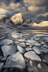 On the rocks (Ron Jansen - EyeSeeLight Photography) Tags: norway lofoten snow ice winter frozen light sunrise mountain dramatic mood piece chunk clouds nordland