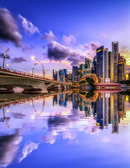 Mirrored city (Rexer Ong) Tags: cityscape reflection water urban clouds bridge river building cbd