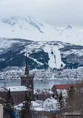 Church of Narvik (kevin-palmer) Tags: norway arctic europe winter march snow snowy arcticocean sea water fjord mountains nikond750 nikon180mmf28 telephoto stitched narvik church steeple cloudy overcast scandinavianmountains ankenesstranda ofotfjorden cold