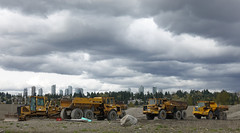 Construction machines (D70) Tags: construction machines volvo trucks bulldozer crawler tractor clouds sand preloading site bigbend burnaby britishcolumbia canada offroad metrotown skyline johndeere