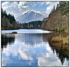 More than a glimmer of shimmer! (john.methven) Tags: glen coe loch water reflection mountain snow peak trees hiking wilderness