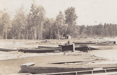 "NE Hillman MI RPPC 1940s WOOD BOATS at the RUSTIC DOCKS at HUNTS LANDING a BOAT LANDING on THE THUNDER BAY RIVER Montmorency County Photographer UNK 1-2 (UpNorth Memories - Donald (Don) Harrison) Tags: vintage antique postcard rppc ""don harrison"" ""upnorth memories"" upnorth memories upnorthmemories michigan history heritage travel tourism restaurants cafes motels hotels ""tourist stops"" ""travel trailer parks"" cottages cabins ""roadside"" ""natural wonders"" attractions usa puremichigan "" ""car ferry"" railroad ferry excursion boats ships bridge logging lumber michpics uscg uslss"