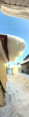 Snow Over-Hanging Roof, Later (sjrankin) Tags: 18february2019 edited kitahiroshima hokkaido japan snow ice weather roof sliding icicles sky panorama