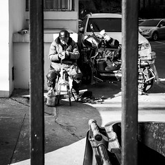 Sharpened like a blade (Go-tea 郭天) Tags: qingdao shandong républiquepopulairedechine cn blade knifes sharpened sharpening sharp duty business old man smoke smoking sun sunny shadow cold winter job work working worker poor bars seat seated busy cap portrait street urban city outside outdoor people candid bw bnw black white blackwhite blackandwhite monochrome naturallight natural light asia asian china chinese canon eos 100d 24mm prime cars motorbike motorcycle tools workshop