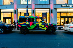Mercedes G-Class with cool paint parked in center of Berlin (wuestenigel) Tags: pattern deutschland abstract decorations holiday berlin geländewagen mercedes colorful wrap mall car gklass germany paint eu vinyl cool de auto street strase transportationsystem transportsystem vehicle fahrzeug city stadt road traffic derverkehr urban städtisch pavement pflaster automotive automobilindustrie bus wheel rad travel reise drive fahrt stock building gebäude light licht downtown innenstadt color farbe noperson keineperson