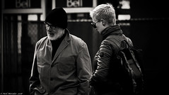 Sometimes life just thows you a curve-ball. (Neil. Moralee) Tags: canadaneilmoraleenikond7100 neilmoralee man woman lady girl couple pair duo two cold hat fight argue divorce street candid toronto canada bw bandw blackandwhite mono monochrome neil moralee contrast backpack people marriage beard moustache outside nikon d7100