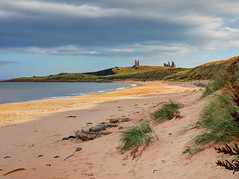 An autumnal day at Embleton Bay (Digidoc2) Tags: beach shoreline coastline coast bay sea northsea sand dunes grass waves hills sky clouds castle ruins landscape nature rocks unitedkingdom england