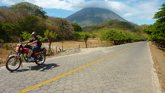 Ometepe on Wheels (Eye of Brice Retailleau) Tags: photographer photographe french francais awesome amazing gorgeous beautiful wonderful website travel photography adventure bright colors colours colourful colorful beauty wide angle backpacking traveller voyage composition perspective pure light scenic view around world earth journey life tourism tourisme tour du monde outdoor outdoors landscape paysage paysaje scenery panorama hike hiking randonnée people portrait selfie selfies self autoportrait central america nicaragua ometepe isla island ile road route motorcycle riding ride