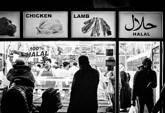 IMG_1100840 (Kathi Huidobro) Tags: urban silhouette afterdark nightphotography london southlondon halal londonshops blackwhite bw monochrome streetphotography candid butchers