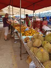 Fruit vendor in Lao market in Phon Phisai (SierraSunrise) Tags: bombaceae durian durio esarn fruit isaan market nongkhai oranges phonphisai thailand vendor