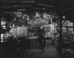 When a talented photographer like Marc Elliott comes to the shop, I'm always curious as to what his eye sees. This shot makes my shop look like a real shop and not a 16'x20' shed. The clutter depiction is spot on. Thank you, Marc. (Chapman Cycles) Tags: