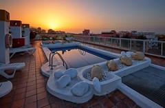Rooftop, Puerto de la Cruz (Vest der ute) Tags: xt20 spain reflections mirror pool houses sunset sky city fav25