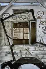 Two Faces & A Window (Solojoe) Tags: graffiti graff saltonsea saltonseabeach junkyard junk urbandecay twofaces faces face window painting artwork 590nm infrared trailerforsaleorrent