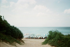 Holiday (kowei) Tags: beach people taiwan ocean sky umbrella sea parasol plants kenting 高雄 白沙灣