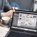 MacBook Pro beside white cup - Credit to https://myfriendscoffee.com/