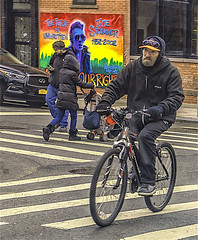 "Candid of Men and Women On The LES (nrhodesphotos(the_eye_of_the_moment)) Tags: dsc080753001084 ""theeyeofthemoment21gmailcom"" ""wwwflickrcomphotostheeyeofthemoment"" walking pedestrian art biker cycling bicycle outdoors reflections shadows brick buildings band street crosswalk les nyc metal colorsofnewyork"