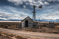 Pioche, Nevada (paccode) Tags: solemn shack landscape desert brush serious quiet abandoned barn dirtroad mountain d850 forgotten scary windmill colorful creepy fence pioche nevada unitedstates us