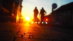 Two On The Run (lucie_may) Tags: czechmeoutblog stickmanblog majestic lenswideopen streetphotography street streetart path city prague people human two sunset car busy flare light orange manual