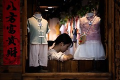 Lijiang Kids' Fashion (Rod Waddington) Tags: china chinese yunnan lijiang old town children kids fashion shop shopping design designer traditional woman window candid streetphotography street store clothes clothing happyplanet asiafavorites