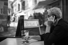 Savouring the Olive (Foto John) Tags: leica leicasl leicasl601 leicasltyp601 mirrorless summicronm50mmƒ2iv blackwhite blackandwhite blackandwhitethatsright monochrome streetphotography people man terrace bar wine olives mobilephone malaga spain espania