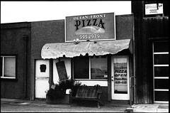 Ocean Front Pizza (greenschist) Tags: california usa cayucos asahipentaxspotmaticii restaurant blackwhite oceanfrontpizza supertakumer55mmf18 35mm analog film kodak trix 400 kodaktrix400