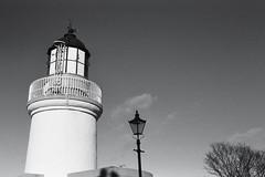 Lighthouse-Lamp-Tree, Cromarty, February 2016 (Mano Green) Tags: lighthouse lamp tree light sky black white cromarty isle scotland winter february 2016 ilford hp5 400 35mm film canon eos 300 40mm lens