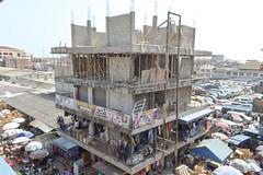 The market is expanding upwards (Francisco Anzola) Tags: ghana accra africa city market tudumarket parasols shops building construction people