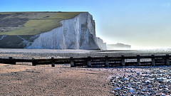 The Beach (Croydon Clicker) Tags: beach groyne sea ocran cliff chalk grass hill sevensisters cuckmerehaven sussex eastsussex shingle stones fence defense mist view haze