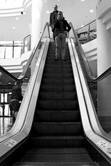 Escalator (lesphotosdepatrick) Tags: fujifilm x100f shoppingmall lacoupolenimes blackandwhitephotography monochrome escalator candidshot leadinglines steps