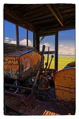 PLOWING THE PRAIRIE (akahawkeyefan) Tags: equipment defunct rusty crusty levers carrizoplain davemeyer sky clouds seat machine mean