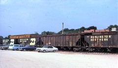 Burlington and Burlington Northern hoppers at Omaha in 1979 (Tangled Bank) Tags: train railway railroad old classic heritage vintage history historical north american equipment burlington northern hoppers omaha 1979 rolling stock bn