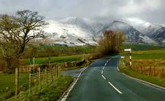 Driving towards mountain Blencathra (lesleydugmore) Tags: road lines grass green mountain signs uk britain europe england lakedistrict blencathra snow white tree clouds outside outdoors rural scenic meadows fields tranquil