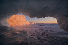 lake superior ice cave (twurdemann) Tags: algoma canada cold cottrellcove fastice frozen fujixt1 highway17 horizon ice icecave icicles lakesuperior lakesuperioricecaves landscape laowa9mm northernontario ontario sawpitbay scenic seascape spring sunset transcanadahighway viveza water winter