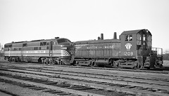 """BM NW2 #1209 with E7 #3818 that was in wreck of the""""Red Wing"""" at Nashua, NH. (Houghton's RailImages) Tags: bm bostonmaine e7 sw9 redwing wreck derailment locomotive diesel bw trains locomotives nashua newhampshire usa"""