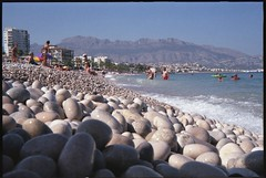 Spain 2018 - The Beach at Albir (Gareth Wonfor (TempusVolat)) Tags: garethwonfor tempusvolat mrmorodo gareth wonfor tempus volat kodak retina film 35mm scan scanned scanning scanner scans epson perfection v200 beach spain 2018 holiday vacance pebbles stones stone pebble beachscene