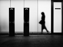 untitled . (helmet13) Tags: leicaxvario bw airport smokingarea people woman silhouette frostedglass picturesfromtheairport heathrow callbox london world100f aoi peaceaward