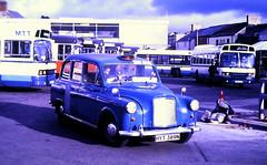 Slide 132-86 (Steve Guess) Tags: merthyr tudful wales gb uk bus station taxi austin fx4 taxibus hyt389n