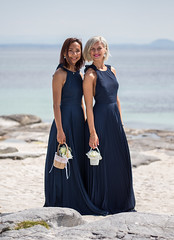 Smiling beauties. (Siggi007) Tags: pose women girls beauty beauties beautiful dress flowers seaside sand nature smiling maidofhonor wedding bridesmaids water beach two canoneos6d sea people outdoor outdoors daylight mood portrait