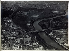 Aerial view of Flinders Street Station and passenger yard. Jolimont workshops and substation in background. Heidelberg and Clifton Hill lines top left. South Suburban to right. (Public Record Office Victoria) Tags: railways train electrification blackandwhite archives victoria aerial melbourne city flinders street workshops jolimont substation bridge yarra river 1919