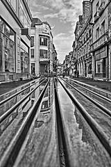 Les songes d'un banc (Tonton Gilles) Tags: alençon normandie hdr noir et blanc banc lignes rue aux sieurs reflets eau flaque nuages paysage urbain