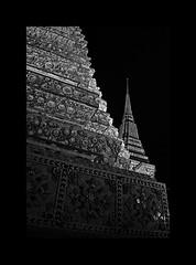 Mysterious shadows (Antoine - Bkk) Tags: temple wat black white stupa thailand bangkok detail ceramic shadow shade