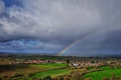 Rainbow over the Somerset Levels. (margaretgeatches) Tags: landscape rainbow raining rain green brown countryside grey blue clouds sky villages hills trees agriculture fields somersetlevels somerset spring