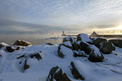 Steam rising on the shore of Lake Superior. (Lucie Maru) Tags: duluth minnesota cold frozen lake lakesuperior lighthouse snow rock rocky rockyshore sunrise fog steam morning