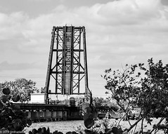 St. Lucie River Drawbridge (Jim Frazier) Tags: 201801floridatrip 2019 bw fec blackandwhite bridges closeup clouds cloudy concrete crossings desaturated detail drawbridges fl flagler florida floridaeastcoastrailroad framing infrastructure january jimfraziercom lagoon leaves macro monochrome q3 railroad railway river roadtrip spans stlucieriver steel structures stuart toexport tracks trains trees up vacation water winter f10 instagram