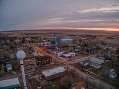 Sunset over Dolan, South Dakota, A Small Farming Town (JacobBoomsma) Tags: agriculture spring freedom ariel snow farming smalltown above rural pride agricultural americanflag midwest silos lake silo grainbin community southdakota farm mainstreet america small town morning grain bin corn buildings starsandstripes village flag city winter summer sunset sunrise aerial drone