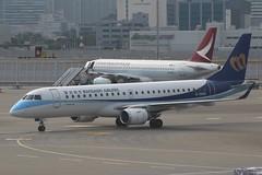 Mandarin Airlines (So Cal Metro) Tags: airline airliner airplane aircraft plane jet aviation airport hongkong hkg b16828 mandarin mandarinairlines embraer e190 regionaljet rj