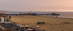 santa monica pier on pacific coast at sunset (DigiDreamGrafix.com) Tags: santa pier monica santamonica ferriswheel color image entertainment nobody horizontal photography travel vacations people park outdoors water sea dusk architecture building exterior structure evening culture american usa built ocean tourism wheel panoramic north ride national america destinations ferris amusement california los county angeles rollercoaster