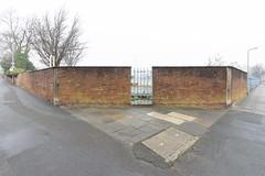 Carlisle, England (stu ART photo) Tags: new topographics urban landscape derelict wall gate blue road wet banal