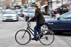 Cold-weather headgear (jeremyhughes) Tags: london knightsbridge cyclist furhat ushanka winter street bicycle bike man cycling urban panning motion speed traffic city mixte nikon d750 nikkor eccentric stylish style afzoomnikkor80200mmf28ded 80200mmf28d